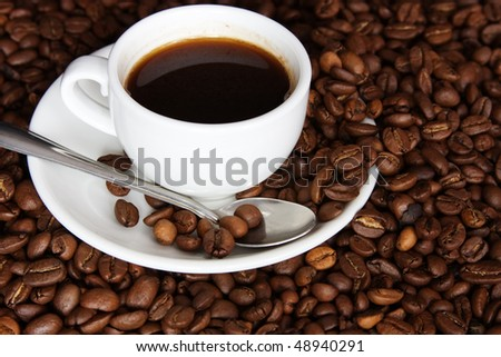 cup of coffee on a background coffee grains