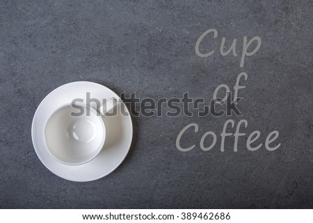 Cup of coffee  on a black wooden table background.