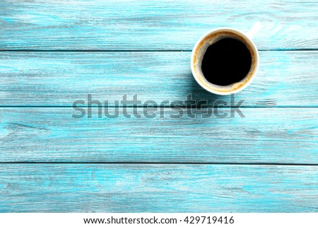 Cup of coffee on a blue wooden table - stock photo