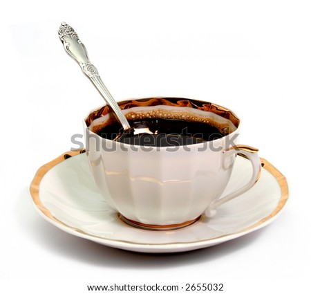 Cup of coffee on a plate with spoon - stock photo