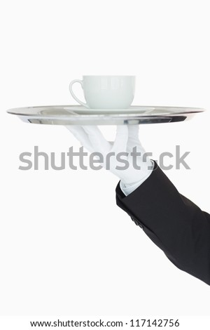 Cup of coffee on a silver tray on white background