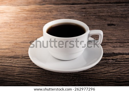 Cup of coffee on a wooden table. retro colors