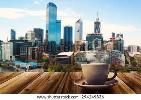 cup of coffee on abstract city background