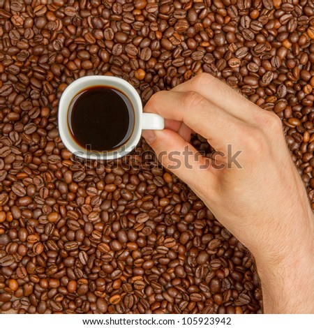 Cup of coffee on aromatic coffee beans. top view - stock photo
