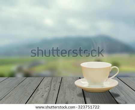 cup of coffee on balcony with nature view behind
