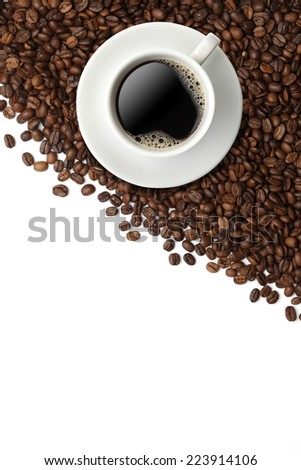 Cup of coffee on coffee beans isolated on white - stock photo