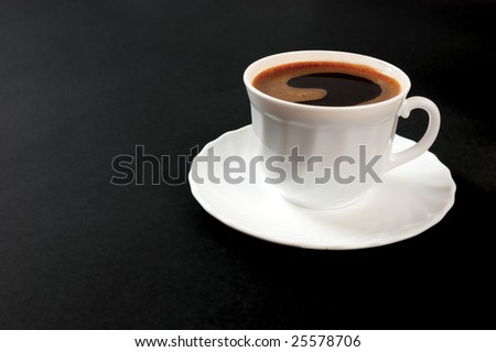 Cup of coffee on dark background - stock photo
