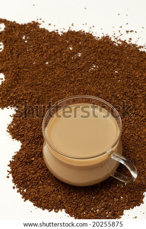 cup of coffee on Instant coffee powder background - stock photo