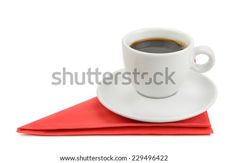 cup of coffee on napkin isolated on white - stock photo