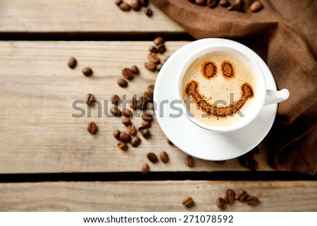 Cup of coffee on old wooden table - stock photo