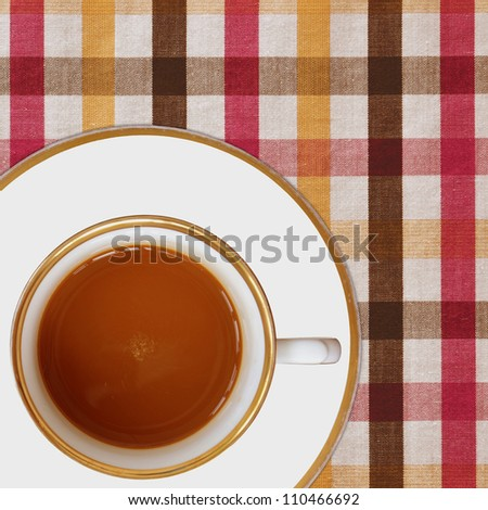 cup of coffee on picnic tablecloth - stock photo