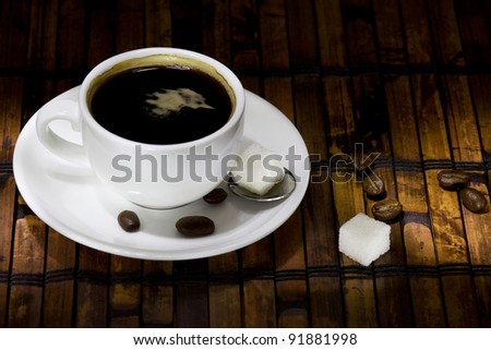 cup of coffee on roasted beans background - stock photo