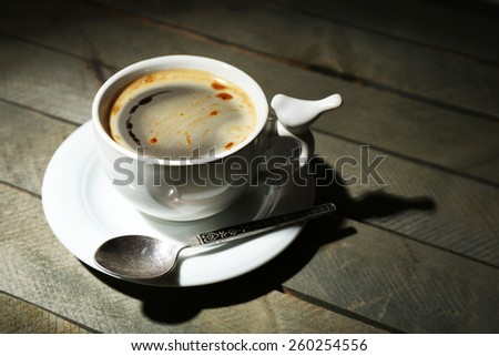 Cup of coffee on rustic wooden planks background - stock photo