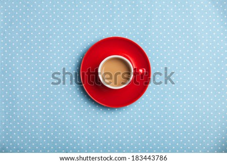 cup of coffee on speckled background. - stock photo