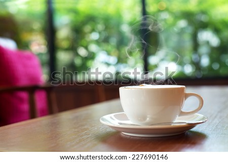 cup of coffee on table in cafe ,Morning light - stock photo