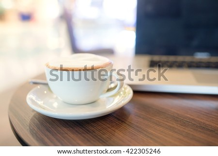 cup of coffee on table in coffee shop cafe - stock photo