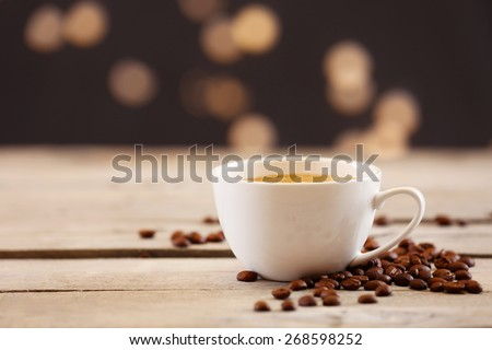 Cup of coffee on table on brown background - stock photo