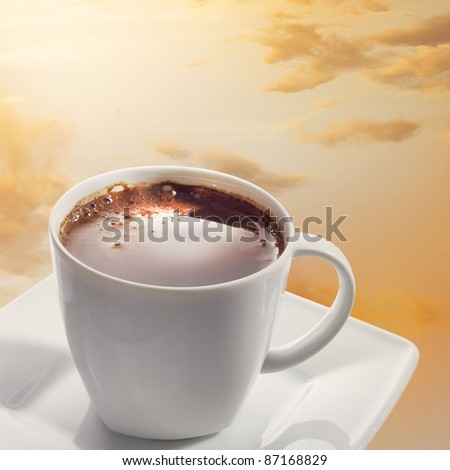 Cup of coffee on the background of the sunset.