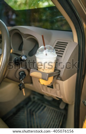 cup of coffee on the console car - coffee cups inside car holder - Coffee Drinking While Driving.  - stock photo
