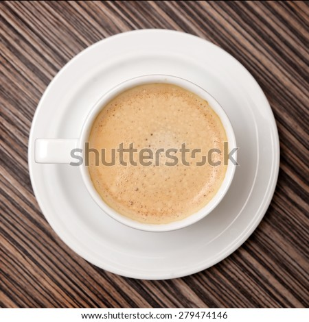 cup of coffee on the table - stock photo