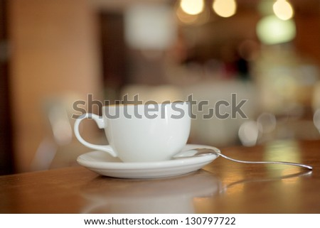 cup of coffee on the table side view and a lot of copy space - stock photo