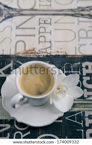 Cup of Coffee on vintage board - stock photo