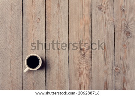 Cup of Coffee on Vintage Wooden Table - stock photo