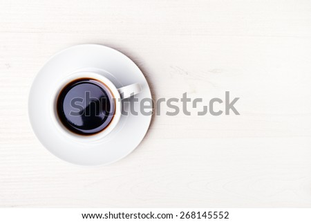 cup of coffee on white wood table - stock photo