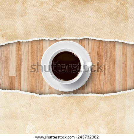 Cup of coffee on wood background with ripped vintage paper. Abstract background for template design. - stock photo