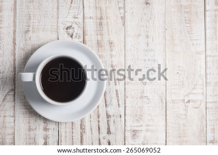 Cup of coffee on wooden table background - stock photo