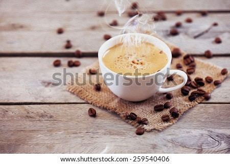 Cup of coffee on wooden table, close up - stock photo