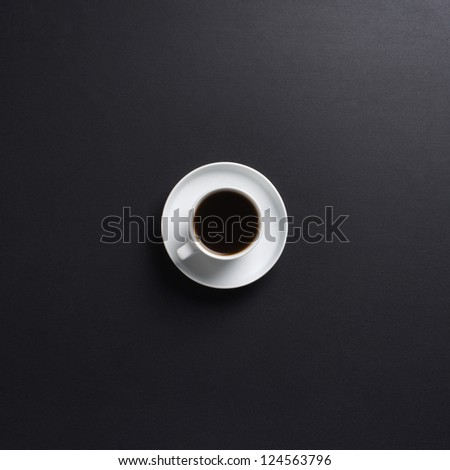 Cup of coffee over the black background - stock photo