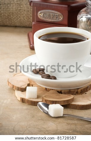 cup of coffee, pot and grinder with roasted beans - stock photo