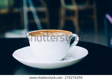 cup of coffee - soft focus with vintage film filter