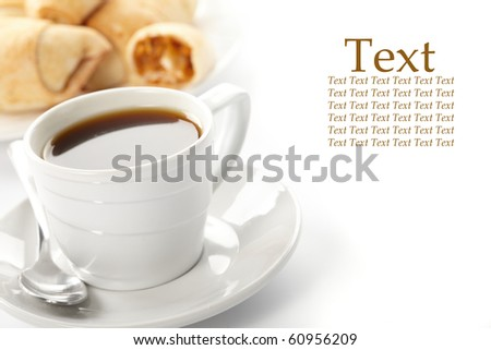 Cup of coffee with a roll - stock photo