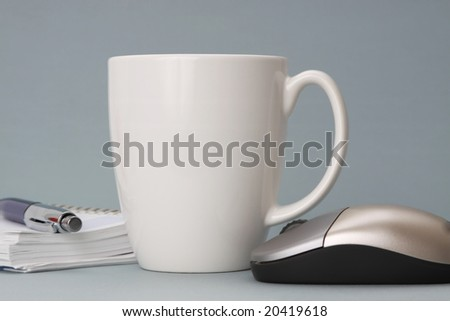 cup of coffee with agenda and computer mouse - stock photo