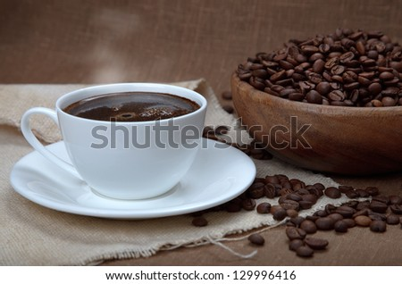 cup of coffee with beans - stock photo
