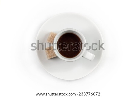 Cup of coffee with brown sugar isolated on white background, top view - stock photo