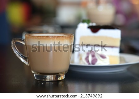 Cup of coffee with cake - stock photo