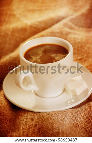 Cup of coffee with canvas background - stock photo