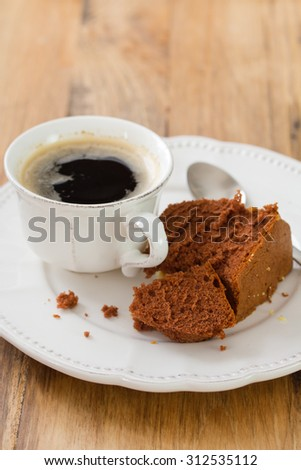 cup of coffee with chocolate cake and spoon