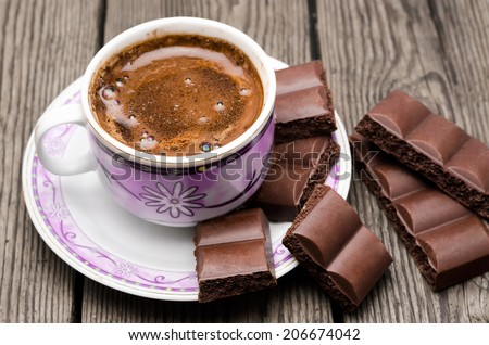 cup of coffee with chocolate on a table - stock photo