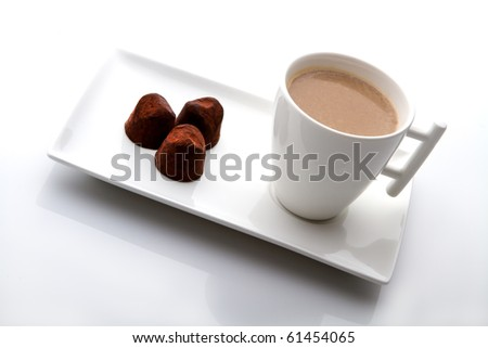 cup of coffee with cocoa candy on white background. - stock photo