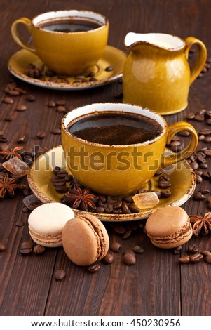 Cup of coffee with cookies and coffee beans - stock photo