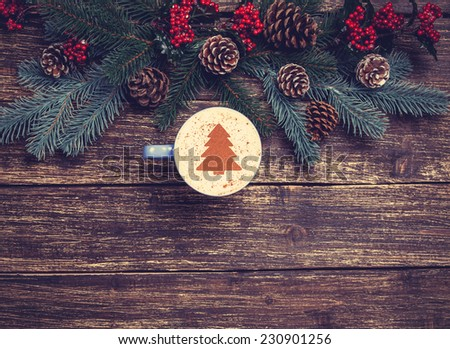 Cup of coffee with cream christmas tree on a table. - stock photo