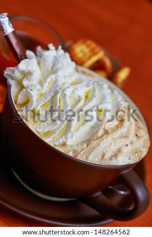 Cup of coffee with cream foam - stock photo