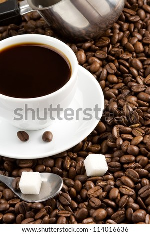 cup of coffee with crop beans as background - stock photo