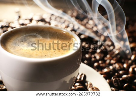 Cup of coffee with grains, closeup - stock photo