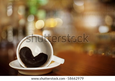 cup of coffee with Heart of Coffee Grounds on Bar, full Frame - stock photo