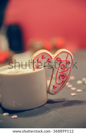 Cup Of Coffee With Heart Shape Cookie On Edge